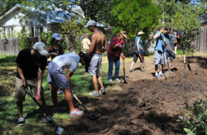 Neighbors dig a new farm plot